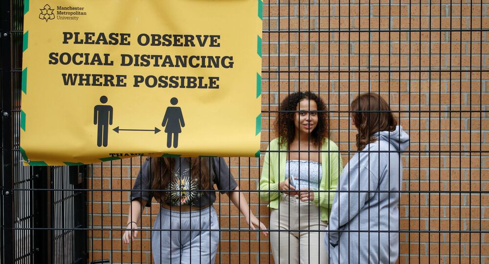Students who are self-isolating stand in the grounds of their student accommodation, following the outbreak of the coronavirus disease (COVID-19) in Manchester, Britain, September 28, 2020