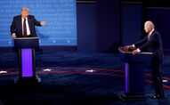 U.S. President Donald Trump and Democratic presidential nominee Joe Biden participate in their first 2020 presidential campaign debate in Cleveland, Ohio, U.S., September 29, 2020.