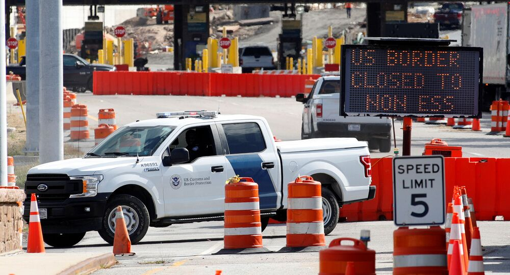 A U.S. Customs and Protection vehicle stands beside a sign reading that the border is closed to non-essential traffic at the Canada-United States border crossing at the Thousand Islands Bridge, to combat the spread of the coronavirus disease (COVID-19) in Lansdowne, Ontario, Canada September 28, 2020.