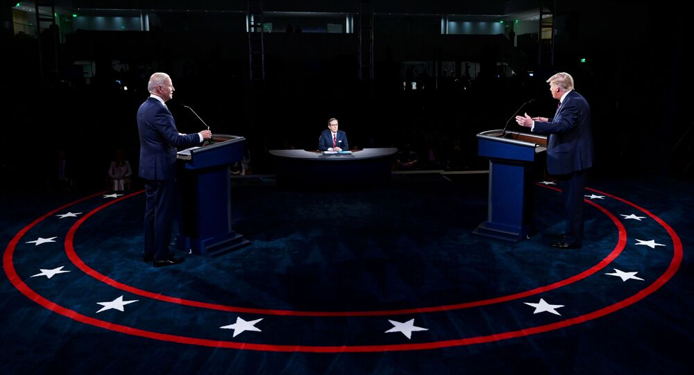 U.S. President Donald Trump and Democratic presidential nominee Joe Biden participate in the first 2020 presidential campaign debate held on the campus of the Cleveland Clinic at Case Western Reserve University in Cleveland, Ohio, U.S., September 29, 2020.