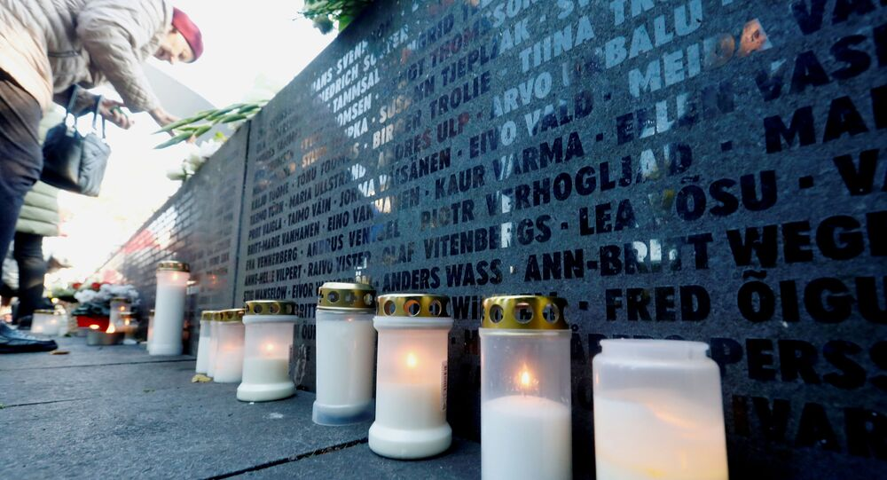 Candles are seen next to the names of victims during a ceremony to mark the 25th anniversary of a maritime disaster when MS Estonia, carrying 803 passengers and 186 crew, sank in the Baltic Sea, in Tallinn, Estonia September 28, 2019