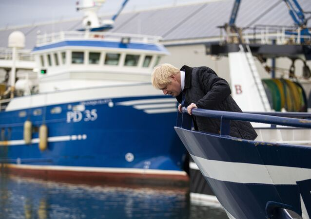 Britain's Prime Minister Boris Johnson looks down from a fishing trawler during a visit to Peterhead in Scotland in September 2019.