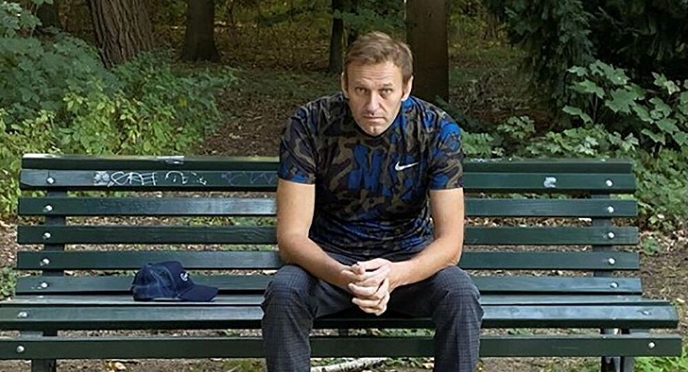 Russian opposition politician Alexei Navalny sits on a bench while posing for a picture in Berlin, Germany, in this undated image obtained from social media September 23, 2020