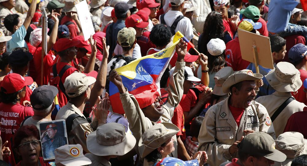 A supporter of Venezuela's President Nicolas Maduro shouts his support for him outside Miraflores presidential palace in Caracas, Venezuela, Monday, May 20, 2109.