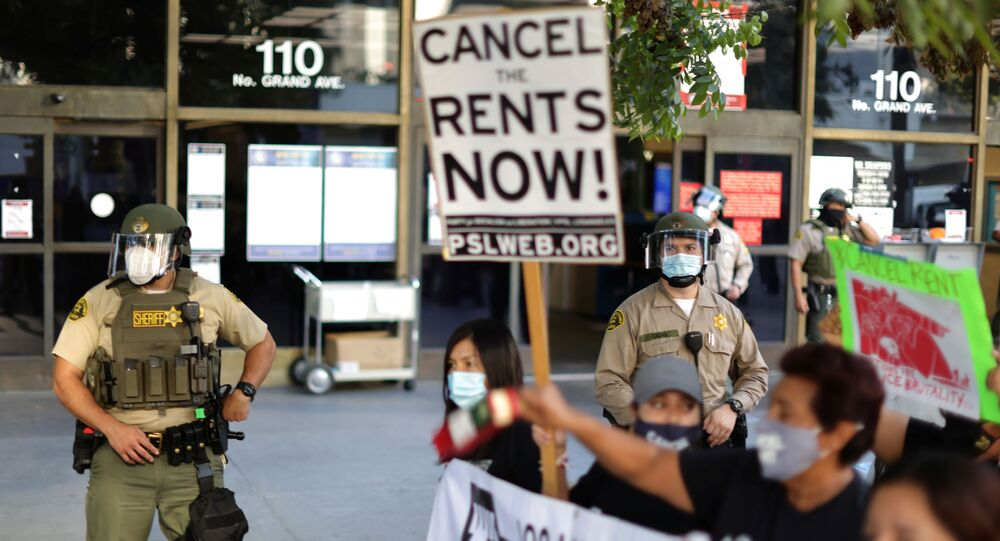 Tenants and housing rights activists protest for a halting of rent payments and mortgage debt as sheriff's deputies block the entrance to the courthouse, during the coronavirus disease (COVID-19) outbreak, in Los Angeles, California, U.S., October 1, 2020.