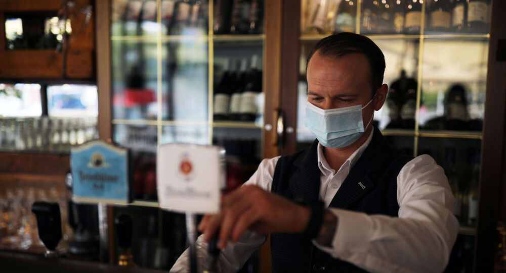 Waiter Ivan wearing a protective face mask works at the Francucci's Ristorante, amid the coronavirus disease (COVID-19) outbreak, in Berlin, Germany, October 1, 2020.