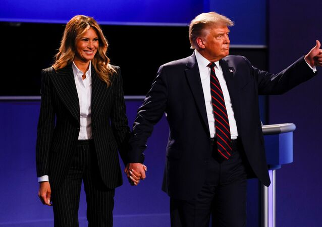 U.S. President Donald Trump and first lady Melania Trump leave the stage at the conclusion of the first 2020 presidential campaign debate with Democratic presidential nominee Joe Biden, held on the campus of the Cleveland Clinic at Case Western Reserve University in Cleveland, Ohio, U.S., September 29, 2020.