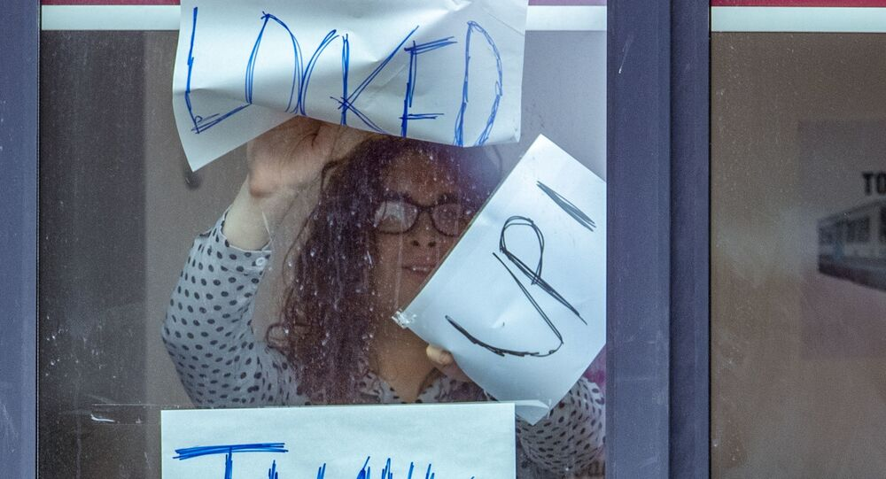 Signs posted on a window at Manchester Metropolitan University's Birley campus, Manchester, Monday Sept. 28, 2020.