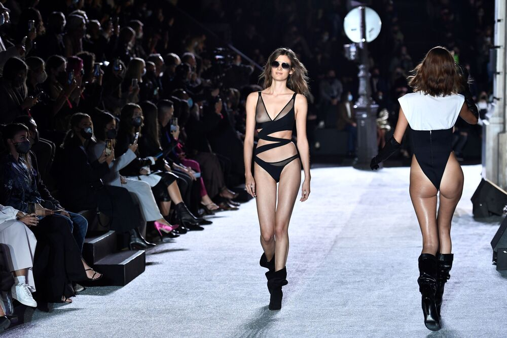 Models present creations by Etam during its 2020 Live Show displaying its Spring/Summer 2021 ready-to-wear lingerie collection in Paris, 29 September 2020.