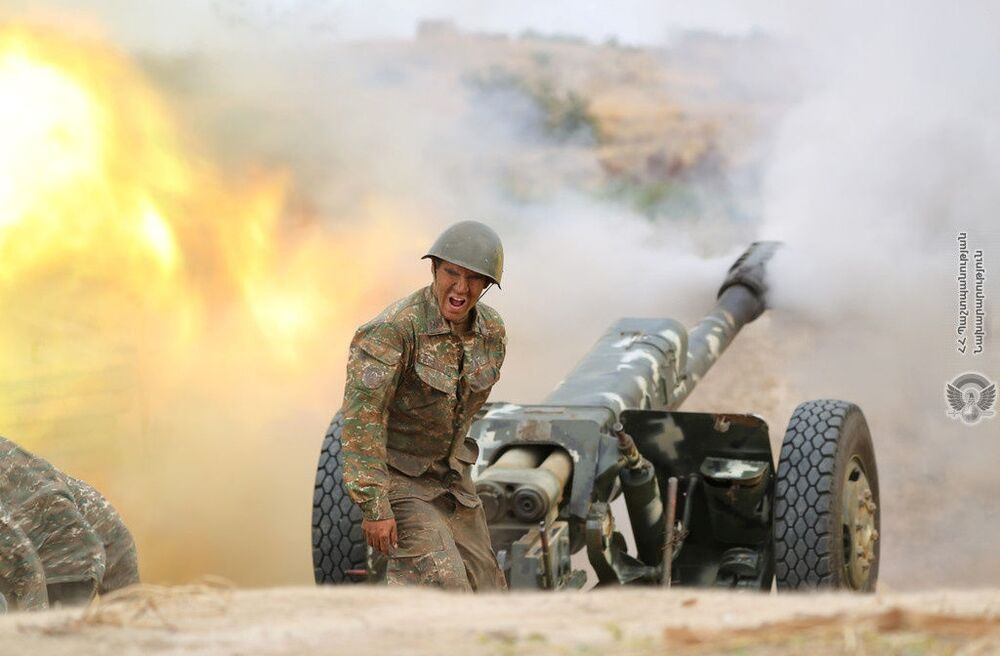 An ethnic Armenian soldier fires an artillery piece during clashes with Azerbaijan's forces in the breakaway region of Nagorno-Karabakh, in this handout picture released 29 September 2020.