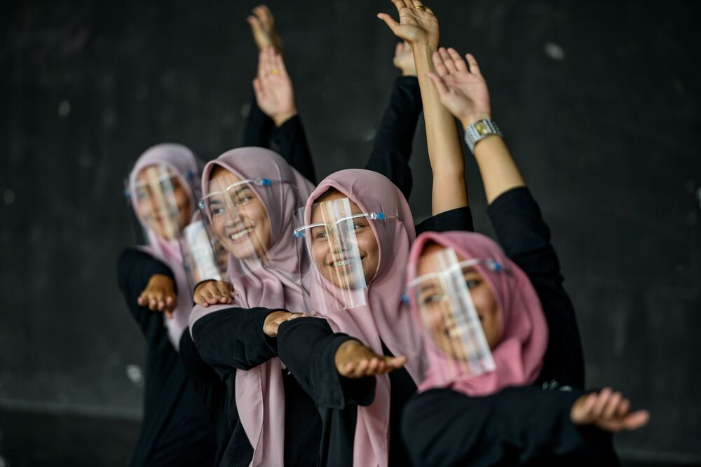 Dancers don face shields to protect themselves against Covid-19 as they perform a practice session at an art and cultural centre in Banda Aceh on 26 September 2020.