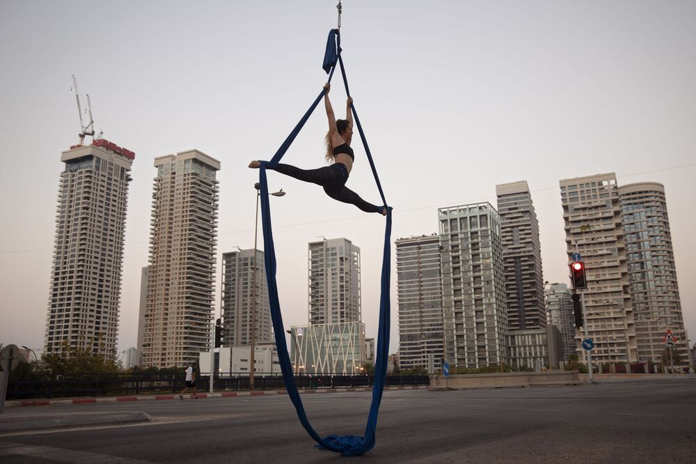 Israeli acrobat Shay Rylski performs on a car-free road, during the Jewish holiday of Yom Kippur, in Tel Aviv, Israel, Monday, 28 September 2020. Yom Kippur, or The Day of Atonement, is the holiest holiday of the Jewish year and annually sees Israeli life grind to a halt. This year it came as the nation, like so many others, was already under a coronavirus lockdown.