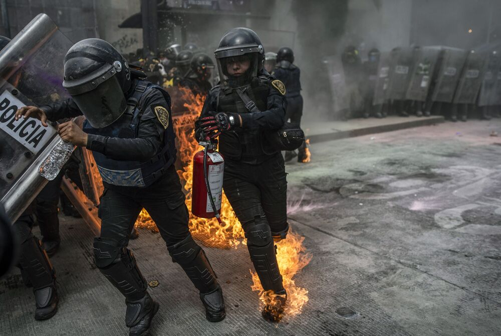Supporters of the legalisation of abortion clash with riot police during a demonstration on International Safe Abortion Day, in Mexico City on 28 September 2020.