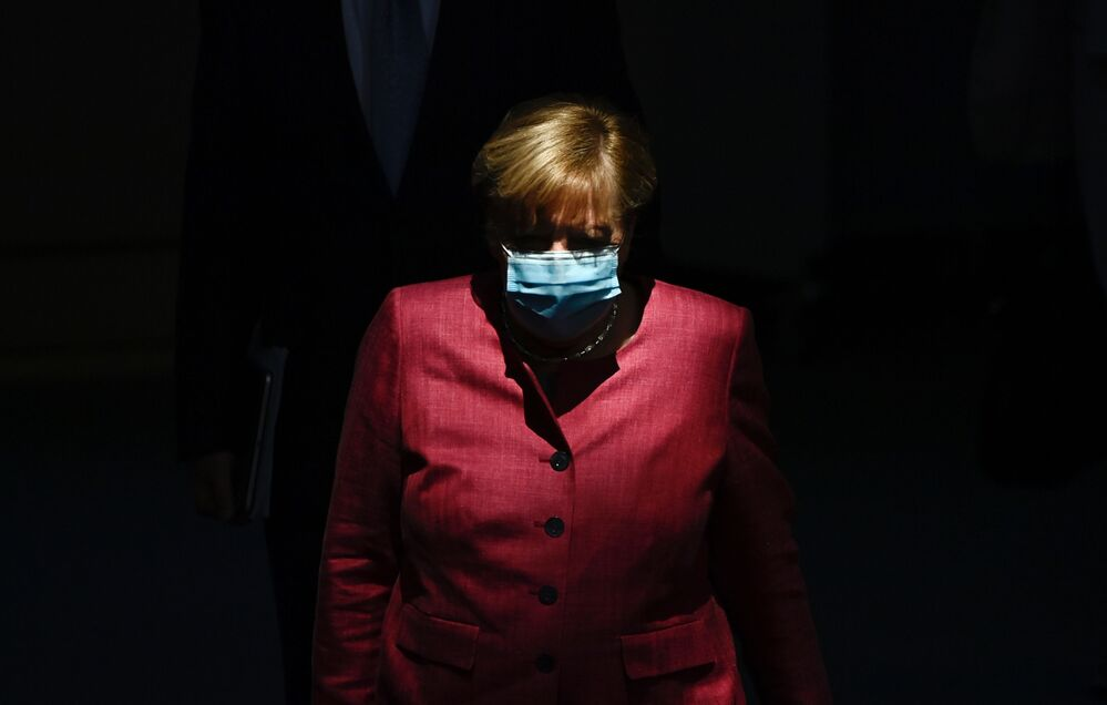 German Chancellor Angela Merkel wears a face mask as she arrives for a session of the Bundestag, or German lower house of parliament, in Berlin on 30 September 2020.