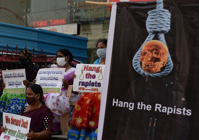 Members of the National Federation of Indian Women (NFIW) hold placards during a protest following accusations of Indian Police forcibly cremating the body of a 19-year-old woman victim, who was allegedly gang-raped by four men in Bool Garhi village of Uttar Pradesh state, in Hyderabad on October 2, 2020.