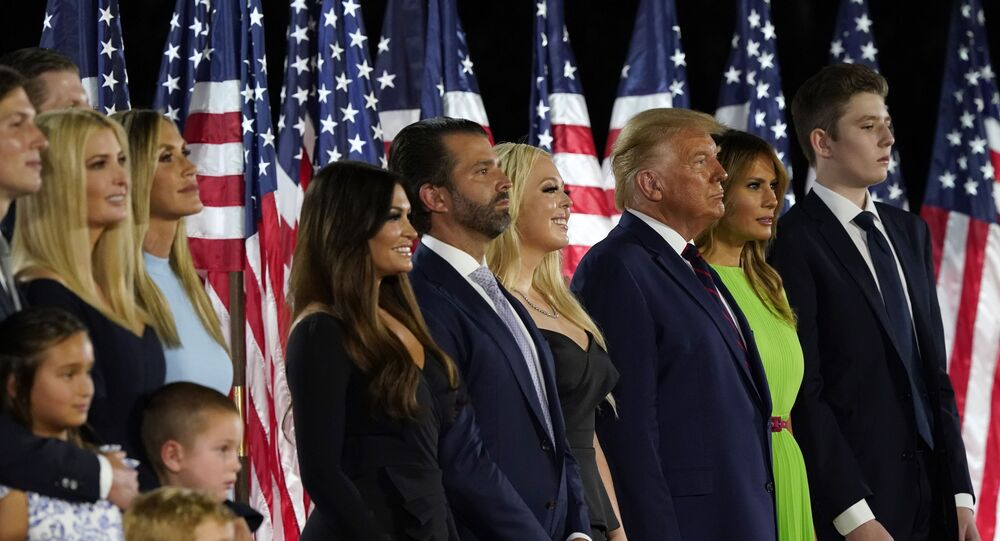 From left, Jared Kushner and his wife Ivanka Trump, Eric and Lara Trump, Kimberly Guilfoyle and Donald Trump Jr., Tiffany Trump, President Donald Trump and first lady Melania Trump and Barron Trump stand on stage on the South Lawn of the White House on the fourth day of the Republican National Convention, Thursday, 27 August 2020, in Washington, DC