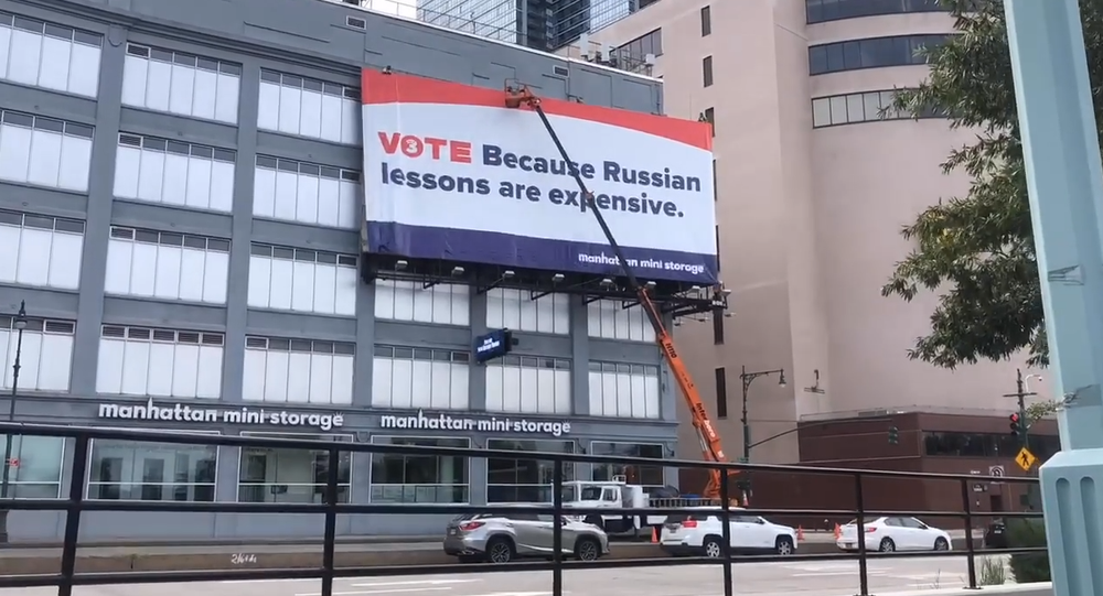 Controversial billboard in Manhattan reading 'Vote Because Russian lessons are expensive.'