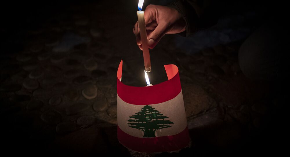 Lebanese living in Chile hold a candle-lit vigil in front of their embassy in Santiago, in memory of the victims of the Beirut blast, on August 10, 2020