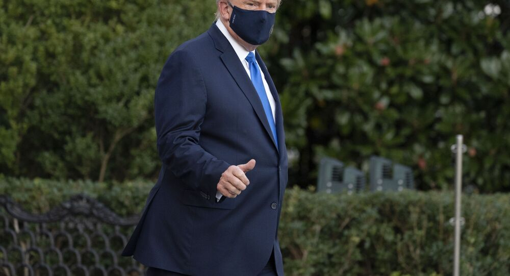 President Donald Trump gives thumbs up as he leaves the White House to go to Walter Reed National Military Medical Center after he tested positive for COVID-19, Friday, Oct. 2, 2020, in Washington.