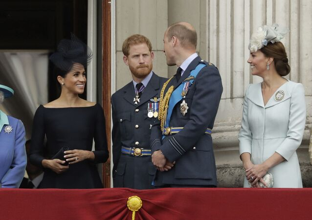 Meghan the Duchess of Sussex, left, Prince Harry, second left, Prince William and Kate the Duchess of Cambridge watch a flypast of Royal Air Force aircraft pass over Buckingham Palace in London, Tuesday, July 10, 2018