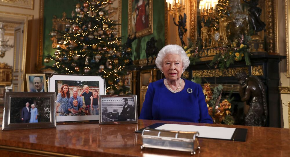 In this image released Tuesday 24 Dec, 2019, Britain's Queen Elizabeth II poses for a photo, while recording her annual Christmas Day message to the nation, at Windsor Castle, England