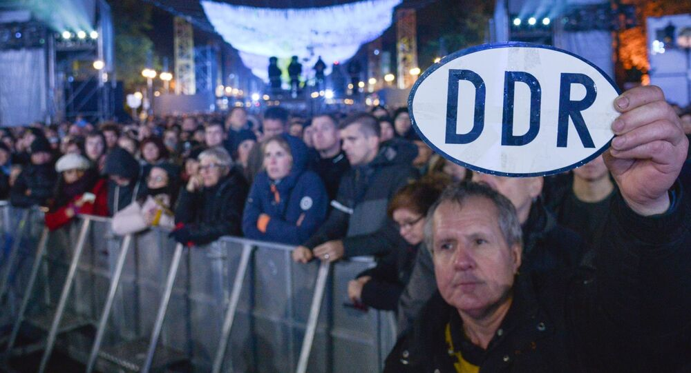 Germans watch a concert at Brandenburg Gate in a ceremony marking the 30th anniversary of the fall of the Berlin Wall. November 2019.