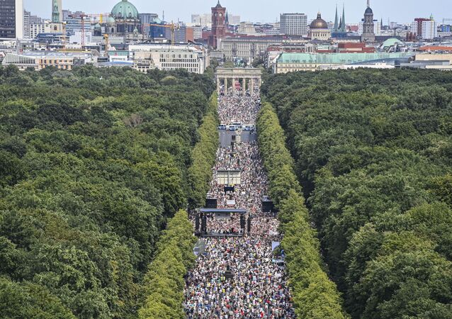 People take part in a demonstration by the initiative Querdenken-711 with the slogan the end of the pandemic-the day of freedom to protest against the current measurements to curb the COVID-19 spreading in Berlin, on August 1, 2020.