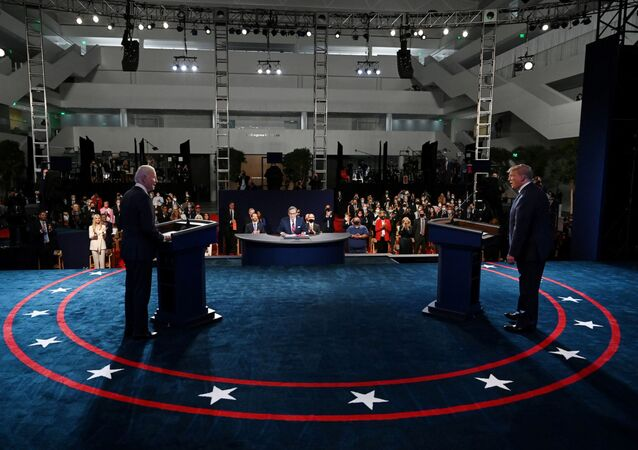 US President Donald Trump and Democrat presidential candidate, former Vice-President Joe Biden participate in the first presidential debate at Case Western University and Cleveland Clinic, in Cleveland, Ohio 29 September 2020. Olivier Douliery/Pool via REUTERS