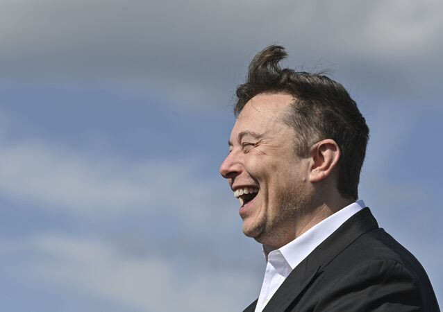 Technology entrepreneur Elon Musk laughs as he visits the Tesla Gigafactory construction site in Gruenheide near Berlin, Germany, Sept. 3, 2020.