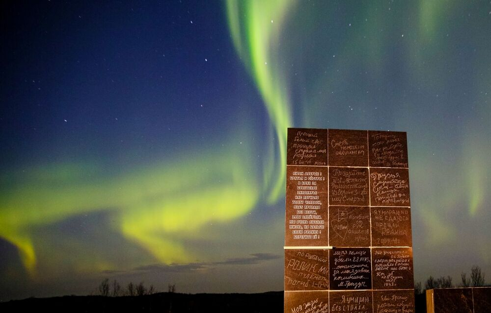 Northern lights over the Valley of Glory memorial in the Murmansk region.