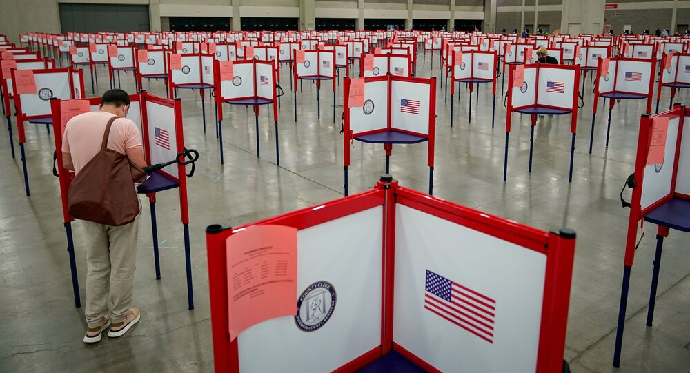 A voter completes his ballot on the day of the primary election in Louisville, Kentucky, U.S. June 23, 2020