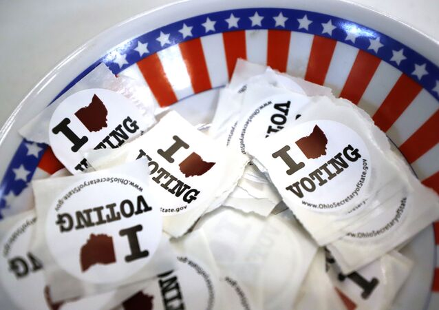 This is a bowl of stickers for those taking advantage of early voting, Sunday, March 15, 2020, in Steubenville, Ohio