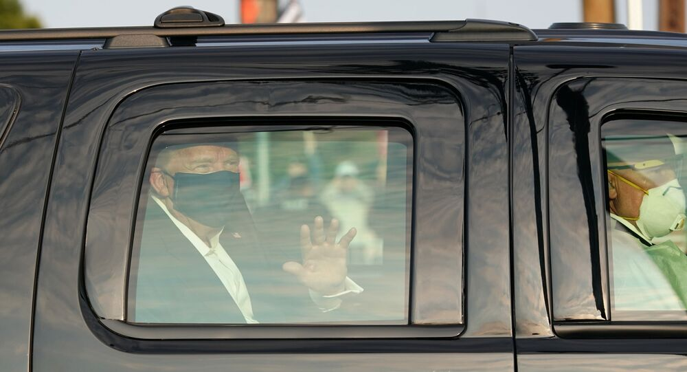 A car with US President Trump drives past supporters in a motorcade outside of Walter Reed Medical Center in Bethesda, Maryland on October 4, 2020.