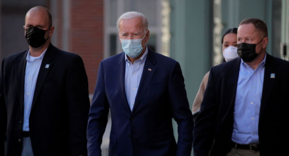 U.S. Democratic presidential candidate and former Vice President Joe Biden exits The Queen theater after a virtual event in Wilmington, Delaware, U.S., October 3, 2020.