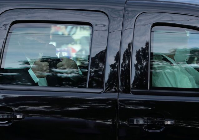 U.S. President Donald Trump rides in front of  the Walter Reed National Military Medical Center, where he is being treated for the coronavirus disease (COVID-19) in Bethesda, Maryland, U.S. October 4, 2020.