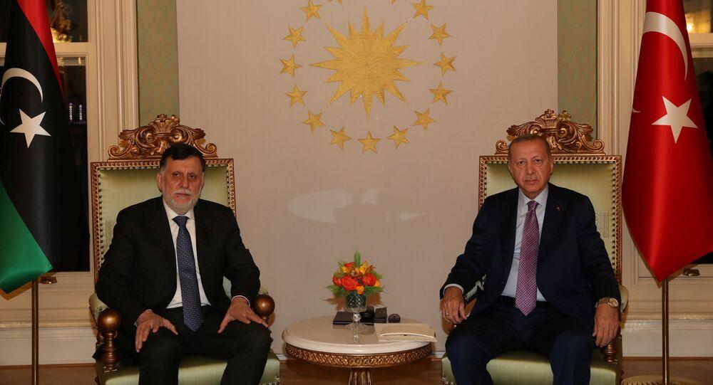 Turkish President Tayyip Erdogan meets with Libya's internationally recognized Prime Minister Fayez al-Sarraj in Istanbul, Turkey, October 4, 2020.