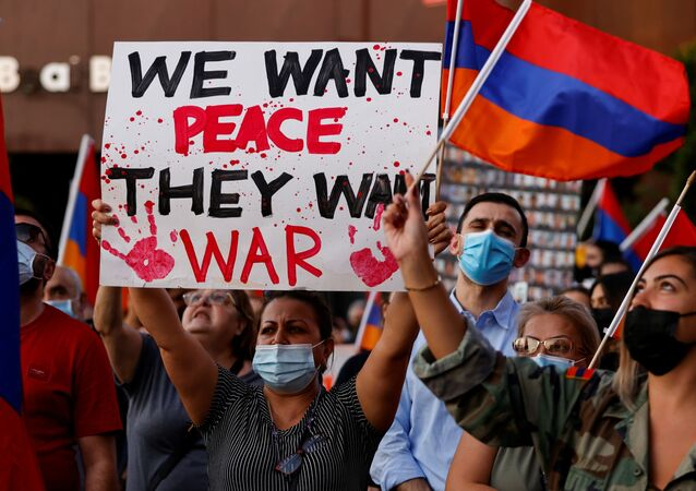 People take part in a protest by Armenian Youth Federation against what they call Azerbaijan's aggression against Armenia and the breakaway Nagorno-Karabakh region outside the Azerbaijani Consulate General in Los Angeles, California, U.S., September 30, 2020.