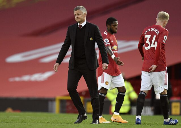 Manchester United's manager Ole Gunnar Solskjaer walks on the pitch at the end of the 6-1 home defeat by Tottenham.