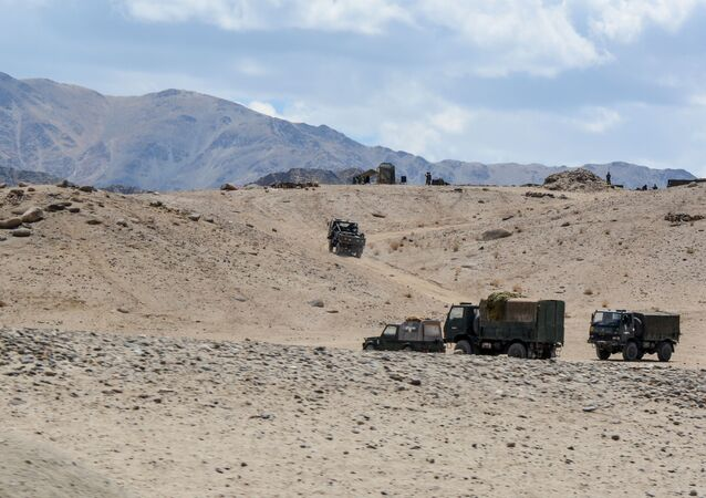 Indian Army personnel drive vehicles as they take part in a military exercise at Thikse in Leh district of the union territory of Ladakh on July 4, 2020