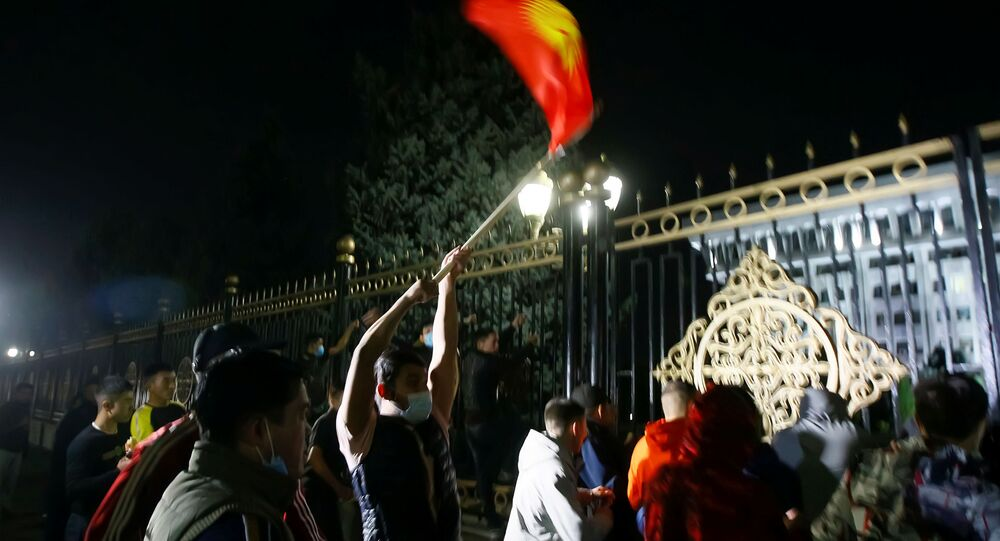 Protesters try to break into the government headquarters during a rally against the result of a parliamentary election in Bishkek, Kyrgyzstan, October 5, 2020