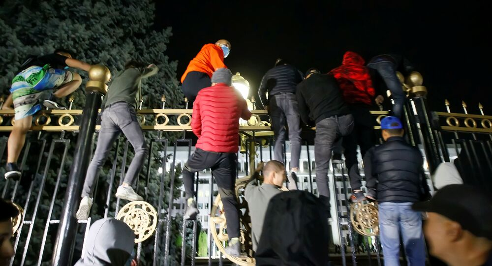 Protesters try to break into the government headquarters during a rally against the result of a parliamentary election in Bishkek, Kyrgyzstan, October 5, 2020.