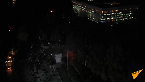 Screenshot from a drone video showing the White House in Bishkek in first minutes after seizure by protesters - Sputnik International