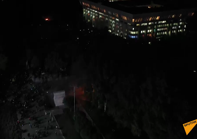 Screenshot from a drone video showing the White House in Bishkek in first minutes after seizure by protesters
