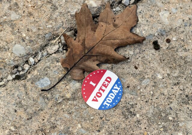A discarded voting sticker lies on the ground at a satellite election office at Overbrook High School on Thursday, Oct. 1, 2020, in Philadelphia. The city of Philadelphia has opened several satellite election offices and more are slated to open in the coming weeks where voters can drop off their mail in ballots before Election Day.