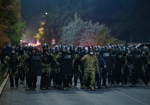 Law enforcement officers are seen during a rally against the parliamentary elections results, in Bishkek, Kyrgyzstan.