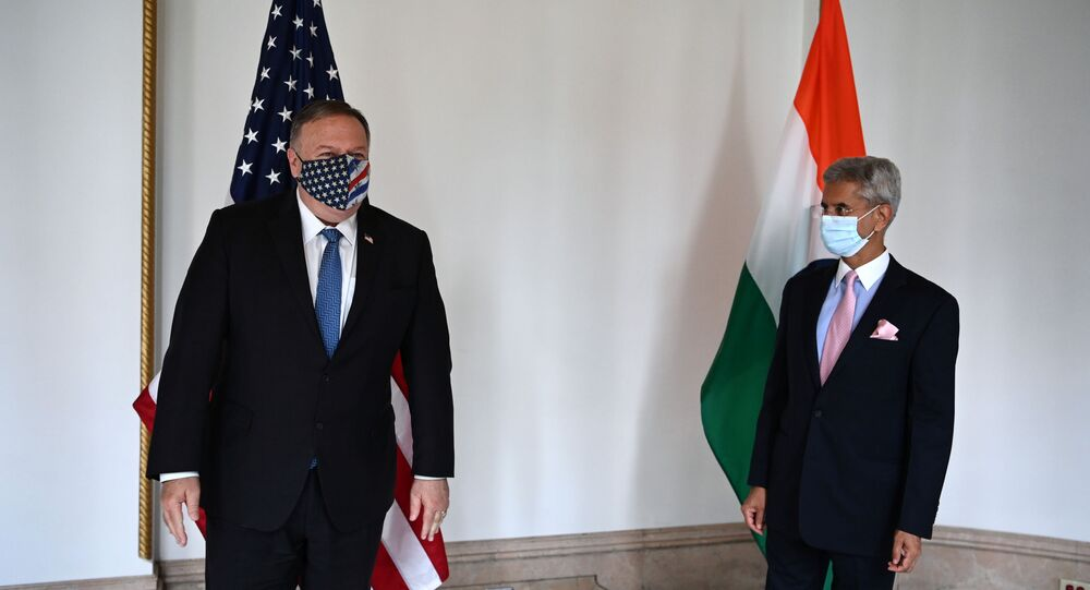 U.S. Secretary of State Mike Pompeo (L) and Indian Foreign Minister Subrahmanyam Jaishankar pose as they attend their meeting in Tokyo on October 6, 2020 ahead of the four Indo-Pacific nations' foreign ministers meeting.