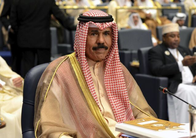FILE - In this Wednesday, March 26, 2014 file photo, Kuwait's Crown Prince Sheik Nawaf Al-Ahmad Al-Jaber Al-Sabah attends the closing session of the 25th Arab Summit in Bayan Palace in Kuwait City
