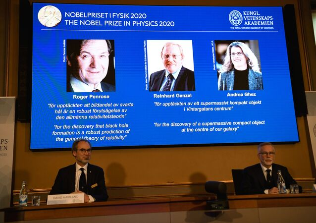 David Haviland, member of the Nobel Committee for Physics and Secretary General of the Royal Swedish Academy of Sciences Goran K. Hansson announce the winners of the 2020 Nobel Prize in Physics presented on the screen: Roger Penrose, Reinhard Genzel and Andrea Ghez during a news conference at the Royal Swedish Academy of Sciences, in Stockholm, Sweden October 6, 2020