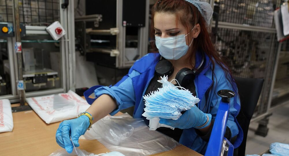 An employee is pictured at the production of medical masks and respirators in Technopolis Moscow, in Moscow, Russia