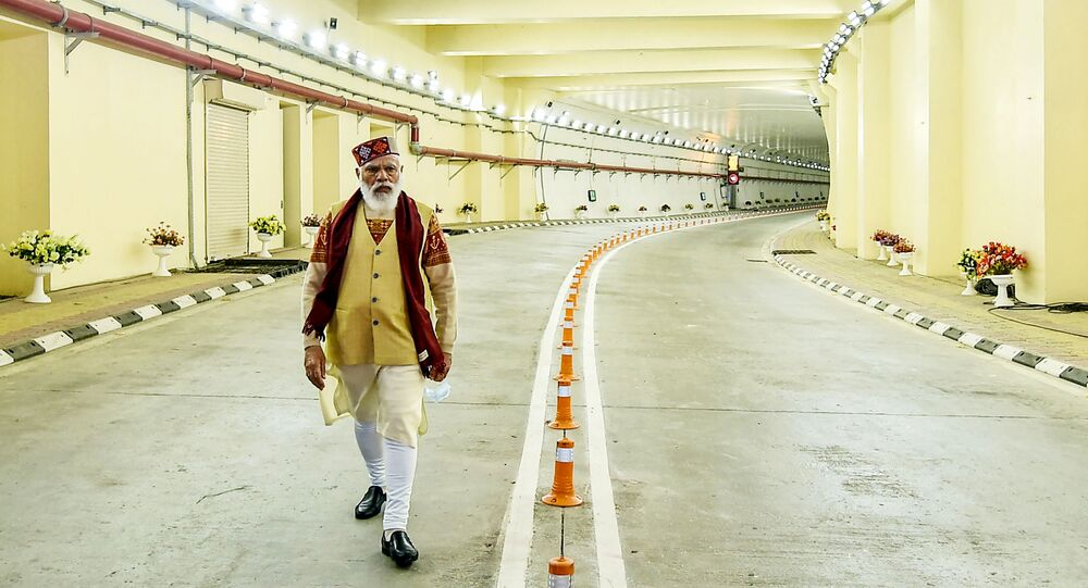 In this handout photograph taken on October 3, 2020 and released by the Indian Press Information Bureau (PIB), India's Prime Minister Narendra Modi walks on a road inside the Highway Atal tunnel, near Manali in Himachal Pradesh state.